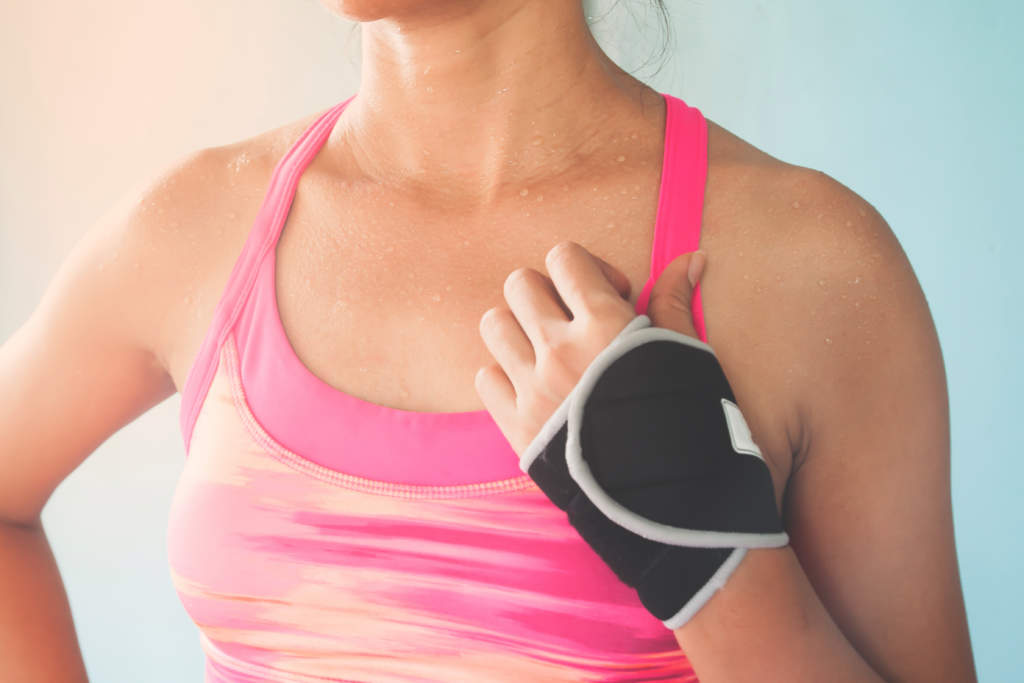 Close up sporty woman in pink color sport bra, Breast cancer, Healthy lifestyle