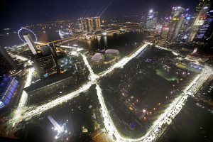 The Singapore F1 Grand Prix's Marina Bay City Circuit is illuminated during a light test as seen from Swissotel The Stamford, Tuesday, Sept. 16, 2014 in Singapore. (AP Photo/Wong Maye-E)