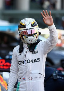 MEXICO CITY, MEXICO - OCTOBER 29: Lewis Hamilton of Great Britain and Mercedes GP waves to the crowd in parc ferme after qualifying in pole position during qualifying for the Formula One Grand Prix of Mexico at Autodromo Hermanos Rodriguez on October 29, 2016 in Mexico City, Mexico. Clive Mason/Getty Images/AFP == FOR NEWSPAPERS, INTERNET, TELCOS & TELEVISION USE ONLY ==