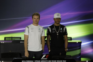 Mercedes driver Lewis Hamilton of Britain, right, and his teammate Nico Rosberg of Germany pose for a picture prior to a news conference at the Yas Marina racetrack in Abu Dhabi, United Arab Emirates, Thursday, Nov. 24, 2016. The Emirates Formula One Grand Prix will take place on Sunday. (AP Photo/Hassan Ammar)