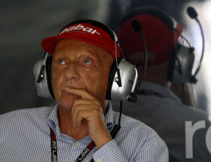 Former Formula One champion and Mercedes non-executive chairman Niki Lauda of Austria watches timing screens during the second practice session for Sunday's Malaysian Formula One Grand Prix at Sepang, Malaysia, Friday, March 22, 2013. (AP Photo/Lai Seng Sin)