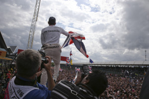 Mercedes driver Lewis Hamilton of Britain celebrates after winning the British Formula One Grand Prix at the Silverstone racetrack, Silverstone, England, Sunday, July 10, 2016. (AP Photo/Luca Bruno)