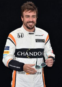 McLaren's Spanish driver Fernando Alonso poses for a photo in Melbourne on March 23, 2017, ahead of the Formula One Australian Grand Prix. / AFP PHOTO / Saeed KHAN / -- IMAGE RESTRICTED TO EDITORIAL USE - STRICTLY NO COMMERCIAL USE --