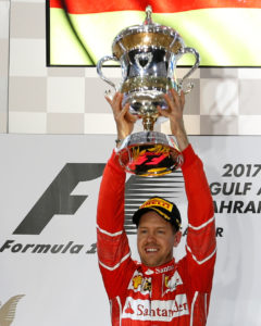Formula One - F1 - Bahrain Grand Prix - Sakhir, Bahrain - 16/04/17 - First place Ferrari Formula One driver Sebastian Vettel of Germany hold the trophy after winning Bahrain Grand Prix. REUTERS/Hamad I Mohammed