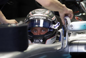 Mercedes driver Valtteri Bottas of Finland is fitted in his car cockpit for the third practice session ahead the Formula One Russian Grand Prix at the 'Sochi Autodrom' circuit, in Sochi, Russia, Saturday, April. 29, 2017. The Russian Formula One Grand Prix will be held on Sunday. (AP Photo/Sergei Grits)
