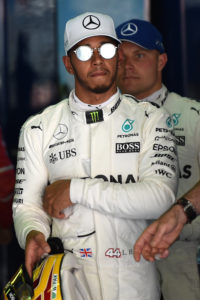 (L to R) Mercedes' British driver Lewis Hamilton and Mercedes' Finish driver Valtteri Bottas walk in the parc ferme after the qualifying session at the Circuit de Catalunya on May 13, 2013 in Montmelo on the outskirts of Barcelona ahead of the Spanish Formula One Grand Prix. / AFP PHOTO / TOM GANDOLFINI