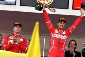 Winner Ferrari's German driver Sebastian Vettel (R) celebrates on the podium next to second placed Ferrari's Finnish driver Kimi Raikkonen after the Monaco Formula 1 Grand Prix at the Monaco street circuit, on May 28, 2017 in Monaco.  / AFP PHOTO / ANDREJ ISAKOVIC
