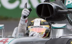 Mercedes driver Lewis Hamilton, of Britain, signals after winning the Canadian Grand Prix auto race in Montreal, Sunday, June 12, 2016. (Graham HUghes/The Canadian Press via AP) MANDATORY CREDIT
