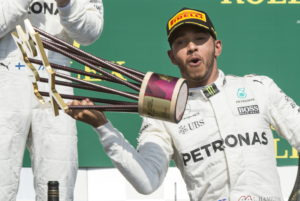 Mercedes driver Lewis Hamilton, of Britain, celebrates his victory at the Canadian Grand Prix auto race Sunday, June 11, 2017, in Montreal. (Pail Chiasson/The Canadian Press via AP)