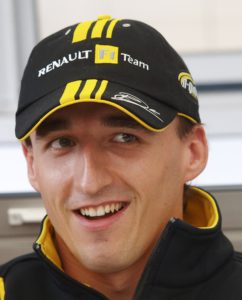 Renault Formula One driver Robert Kubica of Poland talks to the media outside his team garage at the British Formula One Grand Prix  in Silverstone, England, Thursday, July 8, 2010. (AP Photo/Max Nash)
