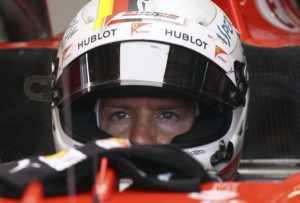 Ferrari driver Sebastian Vettel of Germany sits in his car cockpit during the second practice session for the Austrian Formula One Grand Prix at the Red Bull Ring in Spielberg, Austria, Friday, July 7, 2017. The Austrian Grand Prix will be held on Sunday. (AP Photo/Ronald Zak)