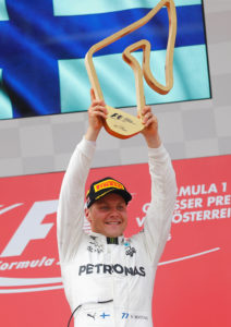 Formula One - F1 - Austrian Grand Prix 2017 - Red Bull Ring, Spielberg, Austria - July 9, 2017   Mercedes' Valtteri Bottas celebrates his win on the podium   Reuters/Dominic Ebenbichler