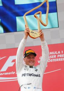 Formula One - F1 - Austrian Grand Prix 2017 - Red Bull Ring, Spielberg, Austria - July 9, 2017 Mercedes' Valtteri Bottas celebrates his win on the podium Reuters/Dominic Ebenbichler