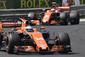 Spain's Fernando Alonso, left, and Belgian F1 driver Stoffel Vandoorne of McLaren steer their cars during Formula One Hungarian Grand Prix on the Hungaroring circuit in Mogyorod, 23 kms north-east of Budapest, Hungary, Sunday, July 30, 2017. (Zoltan Mathe/MTI via AP)