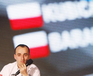 FILE - This is a Thursday, March 14, 2013 file photo of former Formula One driver Robert Kubica at a news conference in Warsaw, Poland. Kubica, who last raced in F1 seven years ago, will drive the Renault F1 car on Tuesday, Aug. 1, 2017, in the first of two days of testing at the Hungaroring circuit in Hungary (AP Photo/Czarek Sokolowski, file)