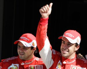 Ferrari driver Fernando Alonso of Spain gives the thumb-up sign after setting the pole position for the Italian Formula One Grand Prix, flanked by his Brazilian teammate Felipe Massa, who set the third fastest time, at the Monza racetrack, in Monza, Italy, Saturday, Sept. 11, 2010. Alonso marked his Ferrari debut at the Italian Grand Prix by taking pole position for the Formula One race. The two-time world champion from Spain set the pace with a lap of 1 minute, 21.962 seconds Saturday for his 19th career pole. It is the Italian team's first pole since the 2008 Brazilian GP, a span of 30 races. (AP Photo/Luca Bruno)