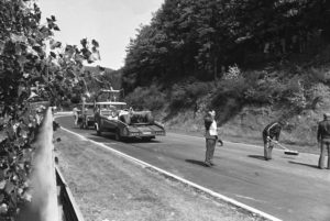 Two rescue cars carrying away damaged race cars of Niki Lauda and Brett Lunger (on first car, at left) and the Hesketh car of German Harald Ertl after spectacular crash during West German Grand Prix at the Nuerburgring circuit on August 1, 1976. Austrian World Champion was injured and taken into hospital. (AP Photo/Hill)