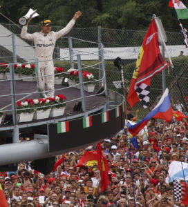 Mercedes driver Nico Rosberg of Germany, celebrates on the podium after winning the Italian Formula One Grand Prix at the Monza racetrack, Italy, Sunday, Sept. 4, 2016. (AP Photo/STR)