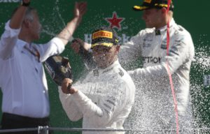 Mercedes driver Lewis Hamilton of Britain celebrates after winning during the Italian Formula One Grand Prix, at the Monza racetrack, Italy, Sunday, Sept. 3, 2017. (AP Photo/Antonio Calanni)