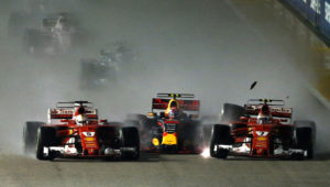 Ferrari driver Kimi Raikkonen, right, of Finland collides with teammate Sebastian Vettel of Germany, left, and Red Bull driver Max Verstappen of the Netherlands at the start of the Singapore Formula One Grand Prix on the Marina Bay City Circuit Singapore, Sunday, Sept. 17, 2017. (AP Photo/Yong Teck Lim)