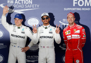 Formula One F1 - Japanese Grand Prix 2017 - Suzuka Circuit, Japan - October 7, 2017. Mercedes' Lewis Hamilton of Britain celebrates pole position in qualifying with Valtteri Bottas of Finland and Ferrari's Sebastian Vettel of Germany. REUTERS/Toru Hanai