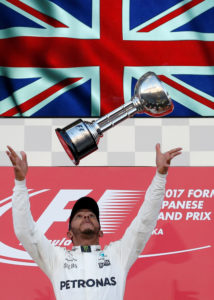 Formula One F1 - Japanese Grand Prix 2017 - Suzuka Circuit, Japan - October 8, 2017. Mercedes' Lewis Hamilton of Britain throws his trophy into the air as he celebrates winning the race. REUTERS/Toru Hanai