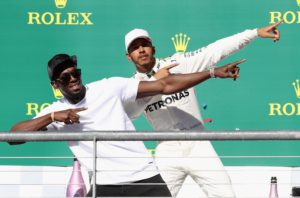 AUSTIN, TX - OCTOBER 22: Race winner Lewis Hamilton of Great Britain and Mercedes GP celebrates on the podium with sprinting legend Usain Bolt during the United States Formula One Grand Prix at Circuit of The Americas on October 22, 2017 in Austin, Texas. Mark Thompson/Getty Images/AFP == FOR NEWSPAPERS, INTERNET, TELCOS & TELEVISION USE ONLY ==