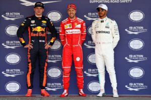 MEXICO CITY, MEXICO - OCTOBER 28: Top three qualifiers Sebastian Vettel of Germany and Ferrari, Max Verstappen of Netherlands and Red Bull Racing and Lewis Hamilton of Great Britain and Mercedes GP pose for a photo in parc ferme during qualifying for the Formula One Grand Prix of Mexico at Autodromo Hermanos Rodriguez on October 28, 2017 in Mexico City, Mexico. Mark Thompson/Getty Images/AFP == FOR NEWSPAPERS, INTERNET, TELCOS & TELEVISION USE ONLY ==
