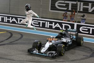 In this picture taken on Sunday, Nov. 27, 2016, Mercedes driver Nico Rosberg of Germany celebrates after finishing second to win the 2016 world championship during the Emirates Formula One Grand Prix at the Yas Marina racetrack in Abu Dhabi, United Arab Emirates. Rosberg's announcement on Friday, Dec. 2, 2016 that he was retiring at the age of 31, five days after earning his first Formula One world championship, shocked the world of motor racing. (AP Photo/Luca Bruno)