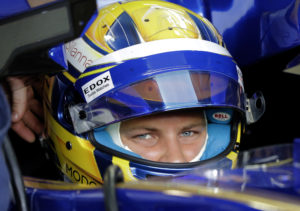 Sauber driver Marcus Ericsson of Sweden waits in his car during the first practice session at the Singapore Formula One Grand Prix on the Marina Bay City Circuit Singapore, Friday, Sept. 15, 2017. (AP Photo/Wong Maye-E)