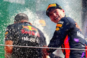MEXICO CITY, MEXICO - OCTOBER 29: Race winner Max Verstappen of Netherlands and Red Bull Racing celebrates on the podium during the Formula One Grand Prix of Mexico at Autodromo Hermanos Rodriguez on October 29, 2017 in Mexico City, Mexico.   Clive Rose/Getty Images/AFP == FOR NEWSPAPERS, INTERNET, TELCOS & TELEVISION USE ONLY ==