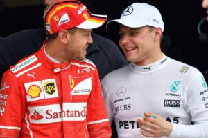 Mercedes' Finnish driver Valtteri Bottas (R) and Ferrari's German driver Sebastian Vettel chat after taking the first and second place for the start of the Brazilian Formula One Grand Prix respectively, in the Q3 qualifying session at the Interlagos circuit in Sao Paulo, Brazil, on November 11, 2017. / AFP PHOTO / Nelson ALMEIDA