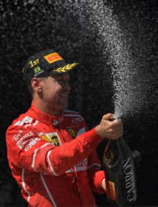 Ferrari's German driver Sebastian Vettel celebrates on the podium after winning the Brazilian Formula One Grand Prix, at the Interlagos circuit in Sao Paulo, Brazil, on November 12, 2017. / AFP PHOTO / Carl DE SOUZA