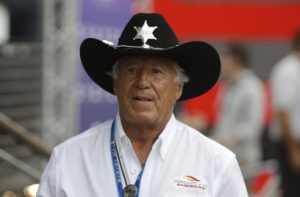 Italian American former Formula One world champion Mario Andretti walks in the paddock at the Monza racetrack, in Monza, Italy , Thursday, Sept. 4 , 2014. The Formula one race will be held on Sunday. (AP Photo/Luca Bruno) / TT / kod 436