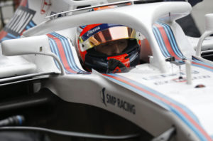 Williams reserve driver Robert Kubica of Poland sits in his car cockpit in the pit lane during a Formula One pre-season testing session at the Catalunya racetrack in Montmelo, outside Barcelona, Spain, Tuesday, Feb. 27, 2018. (AP Photo/Francisco Seco)