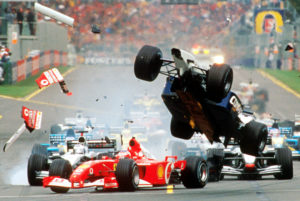 The Williams of Ralf Schumacher of Germany, right, flies over the Ferrari of Brazil's Rubens Barrichello as they collide while heading for the first corner of the first lap of the Australian Formula One Grand Prix in Melbourne, Sunday, March 3, 2002. Both drivers escaped injury but were not able to continue the race eventuly won by Ferrari's Michael Schumacher. (AP Photo/Australian Grand Prix Corp., Joe Mann)
