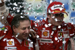 Ferrari team director Jean Todt, left, celebrates with Finland's Kimi Raikkonen after the Brazilian Formula One Grand Prix at the Interlagos race track in Sao Paulo, Sunday, Oct. 21, 2007. By winning one of the most dramatic finales in recent years to clinch his first Formula One title, Kimi Raikkonen capped a brilliant first season with Ferrari.(AP Photo/Victor R. Caivano)