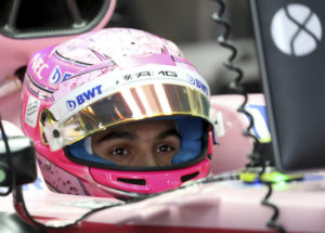 Force India driver Esteban Ocon of France waits in his car during the first practice session at the Japanese Formula One Grand Prix at Suzuka, Japan, Friday, Oct. 6, 2017. (AP Photo/Eugene Hoshiko)