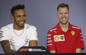 Mercedes driver Lewis Hamilton of Britain and Ferrari driver Sebastian Vettel of Germany, right, laugh during a drivers' press conference at the Australian Formula One Grand Prix in Melbourne, Thursday, March 22, 2018. The first race of the 2018 seasons is on Sunday. (AP Photo/Rick Rycroft)