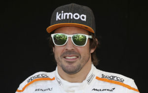 McLaren driver Fernando Alonso of Spain poses for a photo at the Australian Formula One Grand Prix in Melbourne, Thursday, March 22, 2018. The first race of the 2018 seasons is on Sunday. (AP Photo/Rick Rycroft)