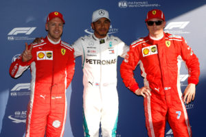 Formula One F1 - Australian Grand Prix - Melbourne Grand Prix Circuit, Melbourne, Australia - March 24, 2018 Mercedes' Lewis Hamilton celebrates pole position after qualifying with Ferrari's Sebastian Vettel and Kimi Raikkonen REUTERS/Brandon Malone