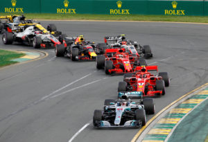 Formula One F1 - Australian Grand Prix - Melbourne Grand Prix Circuit, Melbourne, Australia - March 25, 2018  Mercedes' Lewis Hamilton leads FerrariÕs Kimi Raikkonen at the start of the race  REUTERS/Brandon Malone