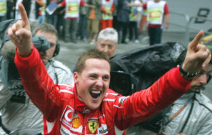 German Ferrari driver Michael Schumacher reacts after winning the Formula One Chinese Grand Prix at the Shanghai International Circuit in Shanghai, China, Sunday, Oct. 1, 2006. (AP Photo/Shizuo Kambayashi)