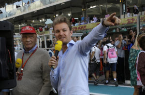 Formula One legend Niki Lauda, left, and last years' champion Nico Rosberg speak on TV ahead of the Emirates Formula One Grand Prix at the Yas Marina racetrack in Abu Dhabi, United Arab Emirates, Sunday, Nov. 26, 2017. (AP Photo/Luca Bruno)