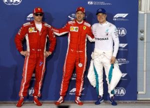 Formula 1 F1 - Bahrain Grand Prix - Bahrain International Circuit, Sakhir, Bahrain - April 7, 2018 Ferrari's Sebastian Vettel celebrates pole position with Ferrari's Kimi Raikkonen and Mercedes' Valtteri Bottas after qualifying REUTERS/Hamad I Mohammed