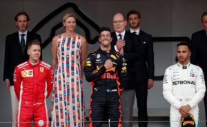 Formula One F1 - Monaco Grand Prix - Circuit de Monaco, Monte Carlo, Monaco - May 27, 2018 Red Bulls Daniel Ricciardo celebrates winning the race with Ferraris Sebastian Vettel finishing second, Lewis Hamilton who finished in third while Prince Albert II of Monaco and Charlene, Princess of Monaco look on REUTERS/Benoit Tessier