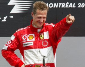 Michael Schumacher, from Germany, points to cheering Ferrari fans as he takes to the podium after winning the Canadian Grand Prix, Sunday, June 13, 2004 in Montreal. (AP Photo/Paul Chiasson) COPYRIGHT PRESSENS BILD Code: 436