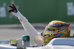 Mercedes driver Lewis Hamilton, of Britain, gestures after winning the Canadian Grand Prix auto race Sunday, June 11, 2017, in Montreal. (Graham Hughes/The Canadian Press via AP)