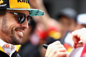 MONTREAL, QC - JUNE 07: Fernando Alonso of Spain and McLaren F1 signs autographs for fans during previews ahead of the Canadian Formula One Grand Prix at Circuit Gilles Villeneuve on June 7, 2018 in Montreal, Canada. Mark Thompson/Getty Images/AFP == FOR NEWSPAPERS, INTERNET, TELCOS & TELEVISION USE ONLY ==