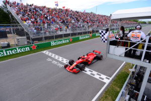 Formula One F1 - Canadian Grand Prix - Circuit Gilles Villeneuve, Montreal, Canada - June 10, 2018   Ferrari's Sebastian Vettel passes the chequered flag to win the race   Paul Chiasson/Pool via REUTERS